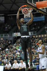 Mike Thomas (13) of Hawaii dunks as a UCSB player looks on at the Stan Sheriff Center in Honolulu, Hawaii on January 3, 2018. Thomas, 6-7 from Woodland Hills, California, played four seasons at Hawaii and left as the winningest player in school history with 87 wins.