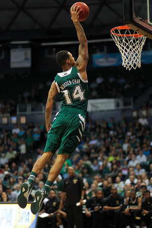 Hawaii's Negus Webster-Chan (14) shows his hops against Arkansas Pine Bluff at the Stan Sheriff Center, Honolulu, Hawaii, on November 14, 2014. A 6-7 guard from Ontario, Canada, Webster-Chan played one season at Hawaii after transferring from Missouri. He led UH in three pointers made (64) that season before foregoing his remaining two years of eligibility to turn pro.