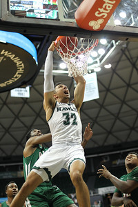 Freshman Samuta Avea (32) of Hawaii slams against Mississippi Valley State at the Stan Sheriff Center in Honolulu, Hawaii on December 16, 2018. Avea, a 6-6 graduate of Kahuku High School, carries on a fine tradition of Rainbow Warriors who don number 32.