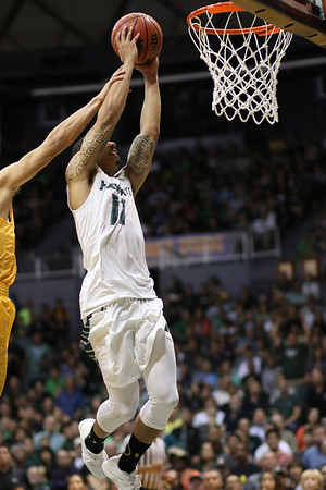 Hawaii guard Quincy Smith (11) draws the contact but finishes the dunk against Long Beach State at the Stan Sheriff Center, Honolulu, Hawaii on January 30, 2016.