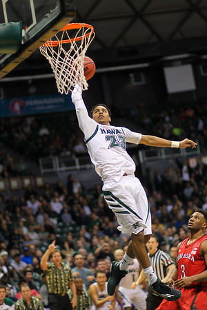 Hawaii's Aaron Valdes (23) dunks on the Nebraska Cornhuskers at the 2014 Diamond Head Classic held at the Stan Sheriff Center, Honolulu, Hawaii on December 22, 2014. Valdes, a 6-5 guard from Whittier, California, was one of the most prolific dunkers in Hawaii history.