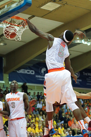 Syracuse forward C.J. Fair (5) withstands an elbow to the face and throws down a lefty slam against Minnesota at the 2013 EA Sports Maui Invitational at the Lahaina Civic Center, Lahaina, Hawaii on November 25, 2013. Fair would later be named a finalist for the Naismith college player of the year.