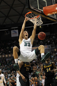 Hawaii junior Stefan Jankovic (33) celebrates a two-handed ham on the Long Beach State 49ers at the Stan Sheriff Center, Honolulu, Hawaii on February 26, 2015. A 6-11 forward from Ontario, Canada, Jankovic was named the Big West Player of the Year after leading UH to the Big West championship. He decided to forego his senior year to turn pro.