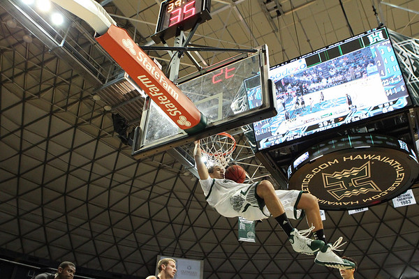 Hawaii sophomore Isaac Fotu (42) hangs after a dunk against Western Michigan at the Stan Sheriff Center, Honolulu, Hawaii on November 9, 2013. Fotu, a 6-8 forward out of Auckland, New Zealand, would be ruled ineligible for the 2014-2015 season as a result of improper benefits.