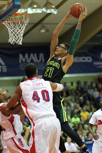 Baylor center Isaiah Austin (21) brings the hammer down on Dayton at the EA Sports Maui Invitational at the Lahaina Civic Center, Lahaina, Hawaii on November 26, 2013. Austin declared for the 2014 draft and was made a ceremonial pick by NBA Commissioner Adam Silver after his diagnosis with Marfan syndrome meant that he could no longer play the game.