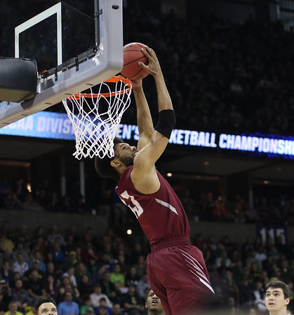 St. Joseph's DeAndre' Bembry (43) flushes a two-handed reverse against Oregon in the second round of the 2016 NCAA Basketball Tournament at Spokane Veteran's Arena, Spokane, Washington on March 20, 2016. Bembry would be drafted 21st overall a few weeks later by the Atlanta Hawks.