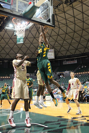 Baylor's Anthony Jones attempts to dunk over Florida State's Chris Singleton during the first half of the Diamond Head Classic. Singleton's Seminoles defeated 15th ranked Baylor, 68-61, in the third place game of the Diamond Head Classic on December 25, 2010.