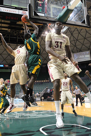 Florida State's Chris Singleton (31) and Bernard James (5) defend Baylor's Quincy Acy's dunk attempt. The Seminoles defeated 15th ranked Baylor, 68-61, in the third place game of the Diamond Head Classic on December 25, 2010.