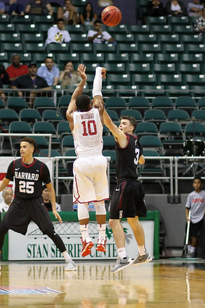 Jordan Woodard of the Oklahoma Sooners shoots over Tommy McCarthy (3) of the Harvard Crimson in the championship game of the Diamond Head Classic at the Stan Sheriff Center, Honolulu, HI on December 25, 2015. Photo: Brandon Flores.