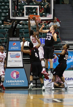 Sooners forward Khadeem Lattin (12) rises for a dunk as Crimson forward Evan Cummins (33) defends in the championship game of the 2015 Diamond Head Classic at the Stan Sheriff Center, Honolulu, HI on December 25, 2015. Photo: Brandon Flores.