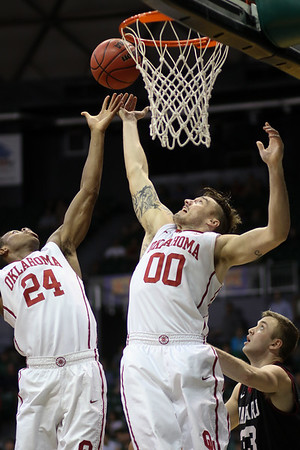 Oklahoma's Buddy Hield (24) and Ryan Spangler (00) leap for the rebound at the championship of the 2015 Diamond Head Classic at the Stan Sheriff Center, Honolulu, HI on December 25, 2015. Photo: Brandon Flores.