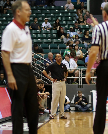 Harvard head coach Tommy Amaker watches the action in the championship game of the 2015 Diamond Head Classic at the Stan Sheriff Center, Honolulu, HI on December 25, 2015. Photo: Brandon Flores.