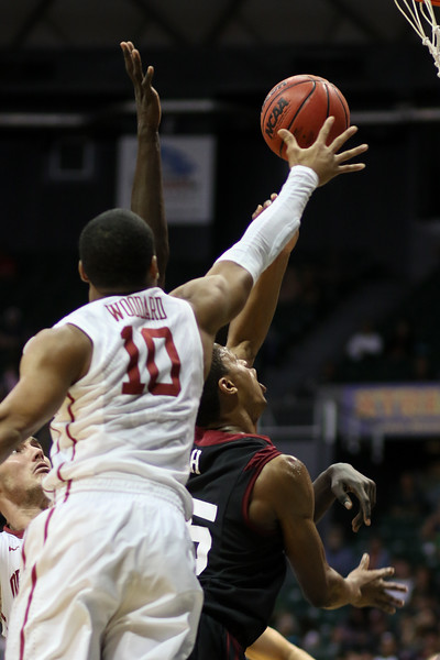 Oklahoma's Jordan Woodard attempts to block a shot of Harvard's Agunwa Okolie in the championship game of the Diamond Head Classic at the Stan Sheriff Center, Honolulu, HI on December 25, 2015. Photo: Brandon Flores.