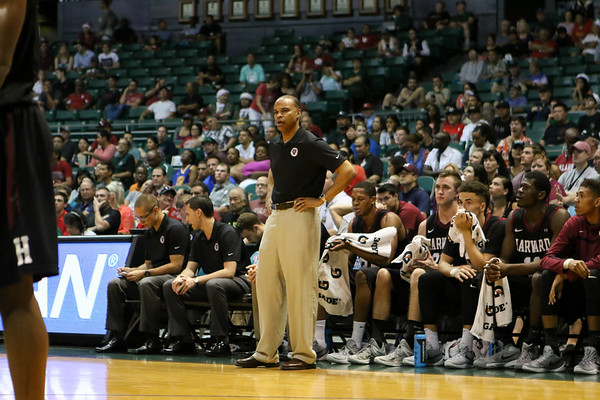 Tommy Amaker of Harvard observes the action in the championship game of the Diamond Head Classic at the Stan Sheriff Center, Honolulu, HI on December 25, 2015. Photo: Brandon Flores.