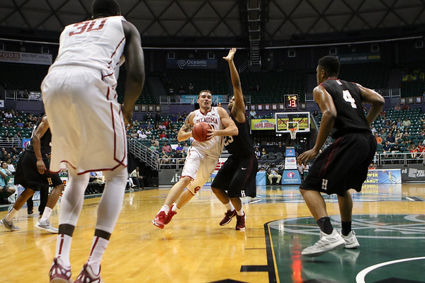 Oklahoma's Ryan Spangler drives on the Harvard defense in the championship game of the Diamond Head Classic at the Stan Sheriff Center, Honolulu, HI on December 25, 2015. Photo: Brandon Flores.