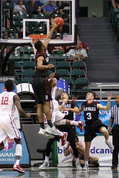 Crimson forward Zena Edosomwan erases a Sooner shot attempt in the championship game of the 2015 Diamond Head Classic at the Stan Sheriff Center, Honolulu, HI on December 25, 2015. Photo: Brandon Flores.