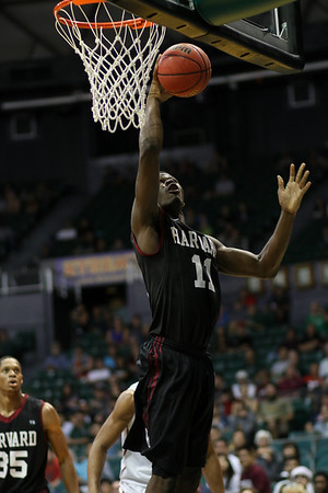 Chris Egi of Harvard lays it in in the championship of the 2015 Diamond Head Classic at the Stan Sheriff Center, Honolulu, HI on December 25, 2015. Photo: Brandon Flores.