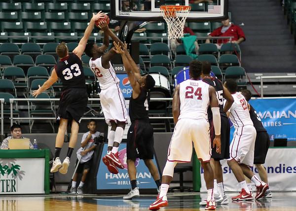 Evan Cummins of Harvard tries to block Khadeem Lattin of Oklahoma's shot in the championship game of the Diamond Head Classic at the Stan Sheriff Center, Honolulu, HI on December 25, 2015. Photo: Brandon Flores.