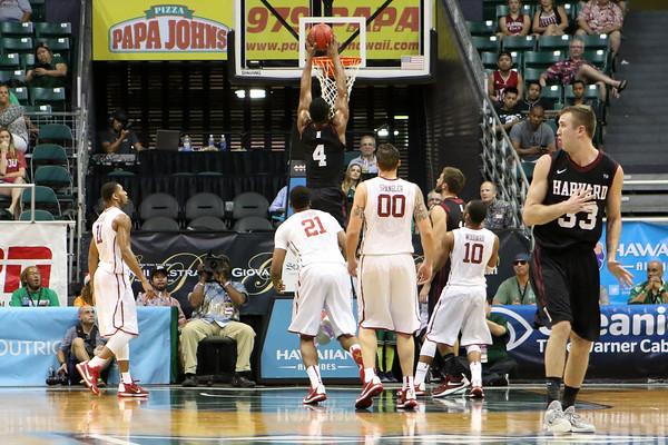 Zena Edosomwan of Harvard dunks on Oklahoma in the championship game of the Diamond Head Classic at the Stan Sheriff Center, Honolulu, HI on December 25, 2015. Photo: Brandon Flores.