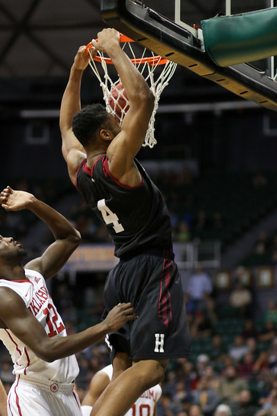 Crimson forward Zena Edosomwan rises for a dunk as Sooner forward Khadem Lattin observes in the championship game of the 2015 Diamond Head Classic at the Stan Sheriff Center, Honolulu, HI on December 25, 2015. Edosomwan double-doubled with a 16 rebounds and a career-high 25 points. Photo: Brandon Flores.