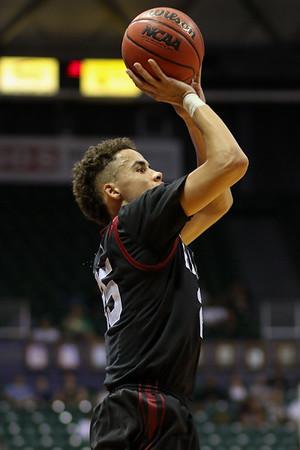 Corey Johnson of Harvard shoots at the championship of the 2015 Diamond Head Classic at the Stan Sheriff Center, Honolulu, HI on December 25, 2015. Photo: Brandon Flores.