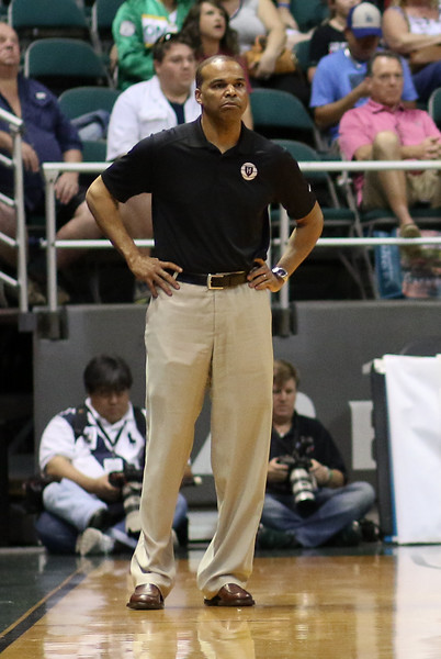 Harvard head coach Tommy Amaker, in his ninth season at the helm, watches his team's performance against Oklahoma at the Stan Sheriff Center, Honolulu, HI on December 25, 2015. Photo: Brandon Flores.