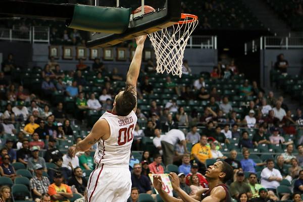 Oklahoma's Ryan Spangler finishes the reverse against Harvard in the championship game of the Diamond Head Classic at the Stan Sheriff Center, Honolulu, HI on December 25, 2015. Photo: Brandon Flores.