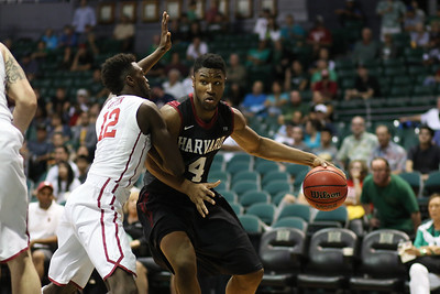 Harvard's Zena Edosomwan drives on Oklahoma's Khadeem Lattin in the championship game of the 2015 Diamond Head Classic at the Stan Sheriff Center, Honolulu, HI on December 25, 2015. Edosomwan double-doubled with a 16 rebounds and a career-high 25 points. Photo: Brandon Flores.