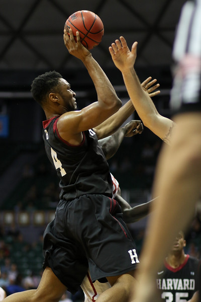 Harvard's Zena Edosomwan hangs for a shot against Oklahoma in the championship game of the Diamond Head Classic at the Stan Sheriff Center, Honolulu, HI on December 25, 2015. Photo: Brandon Flores.