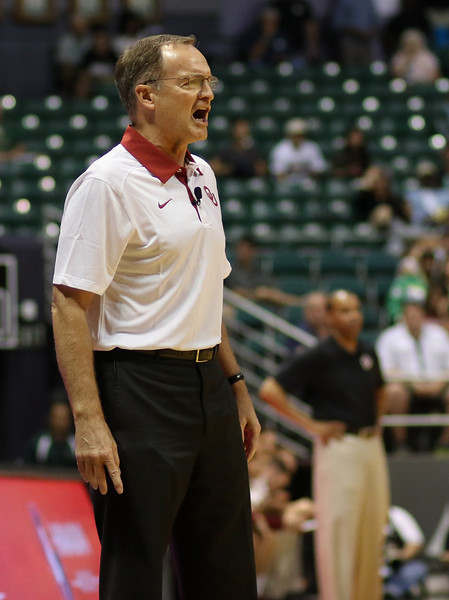 Oklahoma head coach Lon Kruger shouts instructions as Harvard head coach Tommy Amaker looks on in the championship game of the 2015 Diamond Head Classic at the Stan Sheriff Center, Honolulu, HI on December 25, 2015. Photo: Brandon Flores.