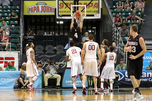 Zena Edosomwan of Harvard dunks on Oklahoma in the championship game of the Diamond Head Classic at the Stan Sheriff Center, Honolulu, HI on December 25, 2015. Edosomwan double-doubled with a 16 rebounds and a career-high 25 points. Photo: Brandon Flores.