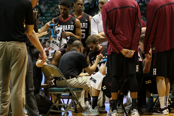 Tommy Amaker of Harvard instructs his players during a timeout in the championship game of the Diamond Head Classic at the Stan Sheriff Center, Honolulu, HI on December 25, 2015. Photo: Brandon Flores.
