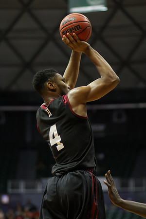 Zena Edosomwan of Harvard shoots over Oklahoma in the championship of the 2015 Diamond Head Classic at the Stan Sheriff Center, Honolulu, HI on December 25, 2015. Edosomwan double-doubled with a 16 rebounds and a career-high 25 points. Photo: Brandon Flores.