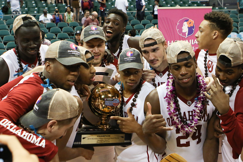 Oklahoma players pose with the championship trophy of the Diamond Head Classic at the Stan Sheriff Center, Honolulu, HI on December 25, 2015.