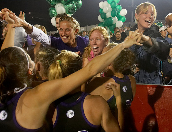 Members from the Northwestern women's lacrosse team celebrate their 11-10 overtime victory over Duke University during the NCAA Women's Lacrosse 2006 semi-finals at Nickerson Field in Boston, Friday, May 26, 2006.