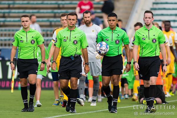 Assistant Referee Garrison Fratoni, Fourth Official Connor Fraley, Center Referee Guido Gonzales, and Assistant Referee Ryan Graves