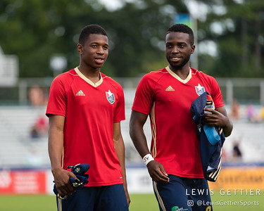 North Carolina FC midfielder Dre Fortune (8) and North Carolina FC defender Peabo Doue (3)
