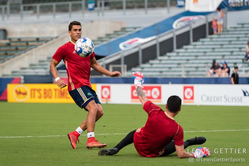 North Carolina FC forward Daniel Rios (14) and North Carolina FC goalkeeper Austin Guerrero (30)
