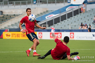 North Carolina FC forward Daniel Rios (14) and North Carolina FC goalkeeper Austin Guerrero (30)