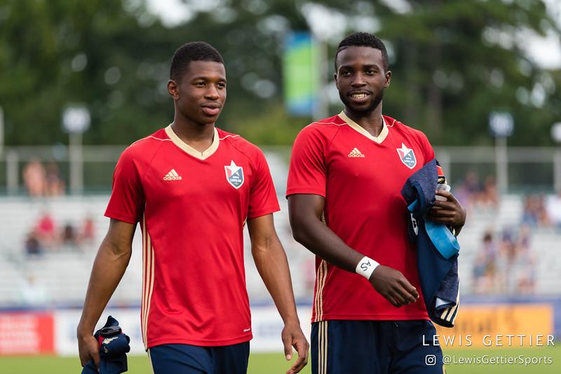 North Carolina FC midfielder Dre Fortune (8) and North Carolina FC defender Peabo Doue (3)