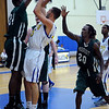 CARL RUSSO/Staff photo. The Northern Essex Community College Knights defeated Massasoit Community College 73-68 in men's basketball action Thursday night. Northern Essex's Will Angelini takes the jump shot over Massasoit defenders Sayvonn Houston (left) and Romain Phoenix (20).  11/15/2012.
