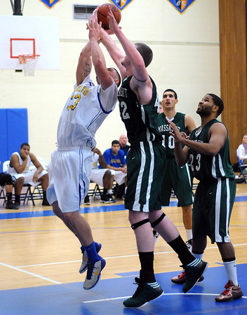 CARL RUSSO/Staff photo. The Northern Essex Community College Knights defeated Massasoit Community College 73-68 in men's basketball action Thursday night. Northern Essex's Kyle Davis fights to make the lay-up against Massasoit's Andrew McCarthy. 11/15/2012.
