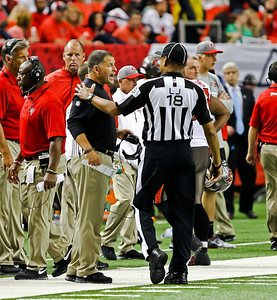 Tampa Bay Buccaneers head coach Greg Schiano had words with the officials during the game between The Atlanta Falcons and The Tampa Bay Buccaneers at The Georgia Dome.