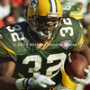 TAMPA, FL - DECEMBER 24: Running Back Reggie Cobb #32 of the Green Bay Packers carries the ball for some extra yardage against the Tampa Bay Buccaneers during a NFL game at Tampa Stadium on December 24, 1994 in Tampa, Florida. Green Bay won the game 34-19. (Photo by Michael J. Minardi) *** Local caption *** Reggie Cobb