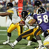 BALTIMORE, MD - OCTOBER 29: Center Dermontti Dawson #63 of the Pittsburgh Steelers blockes Defensive Tackle Sam Adams #95 of the Baltimore Ravens so that the ball carrier Quarterback Kordell Stewart of the Steelers can get some extra yardage during a NFL game at PSINet Stadium on October 29, 2000 in Baltimore, Maryland. The Steelers won 9-6. (Photo by Michael J. Minardi) *** Local Caption *** Dermontti Dawson;Kordell Stewart;Sam Adams