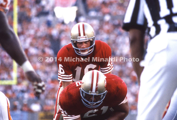 TAMPA, FL - SEPTEMBER 17: QB Joe Montana #16 readies for a snap from Center Jesse Sapolu #61 both from the 49ERS playing against the Tampa Bay Buccaneers on September 17, 1989 at Tampa Stadium in Tampa, Florida. The 49ERS won 20-16. (Photo by Michael Minardi) *** Local Caption *** Joe Montana;Jesse Sapolu