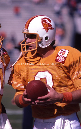 TAMPA, FL - September 15: QB Steve Young #8 of the Tampa Bay Buccaneers speaks with his teammates before a preseason NFL game at Tampa Stadium on September 15, 1985 in Tampa, Florida. Vikings won 31 to 16. (Photo by Michael J. Minardi) *** Local Caption *** Steve Young