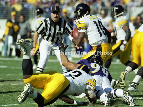 BALTIMORE, MD -OCTOBER 29: Quarterback Kordell Stewart #10 of the Pittsburgh Steelers scrambles out of the pocket in front of Umpire Bill Schuster #129 to avoid being sacked by Defensive End Michael McCrary #99 of the Baltimore Ravens during a NFL game at PSINet Stadium on October 29, 2000 in Baltimore, Maryland. The Steelers won the game 9-6. (Photo by Michael J. Minardi) *** Local Caption *** Kordell Stewart;Bill Schuster;Michael McCrary