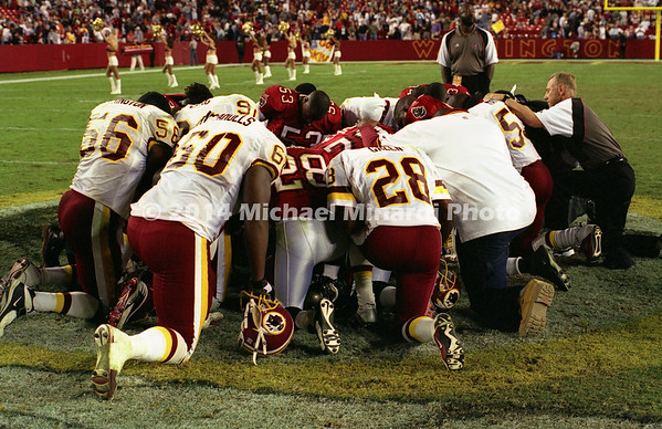 WASHINGTON,DC - OCTOBER 1; Players and coaches pray for a safe game at Washington,DC on a game between the Tampa Bay Buccaneers and the Washington Redskins at Fed Ex Field on October 1, 2000. The Redskins defeated the Buccaneers 20 to 17. (Photo by Michael Minardi) ***Local Caption *** Buccaneers and Redskins