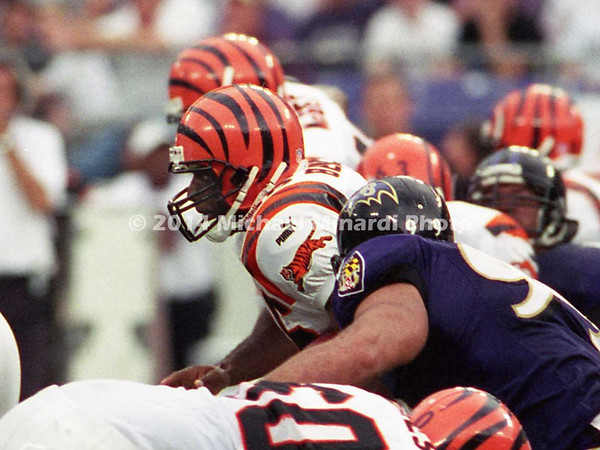 BALTIMORE, MD - SEPTEMBER 24: Half Back Brandon Bennett #36 of the Cincinnati Bengals breaks through the Baltimore Ravens front line for some extra yardage with the help of his teammates Offensive Tackle Willie Anderson #71 and Center Brock Gutierrez #62 in a NFL game at PSINet Stadium on September 24, 2000 in Baltimore, Maryland. The Ravens won the game 37-0. (Photo by Michael J. Minardi) *** Local Caption *** Brandon Bennett;Brock Gutierrez;Willie Anderson
